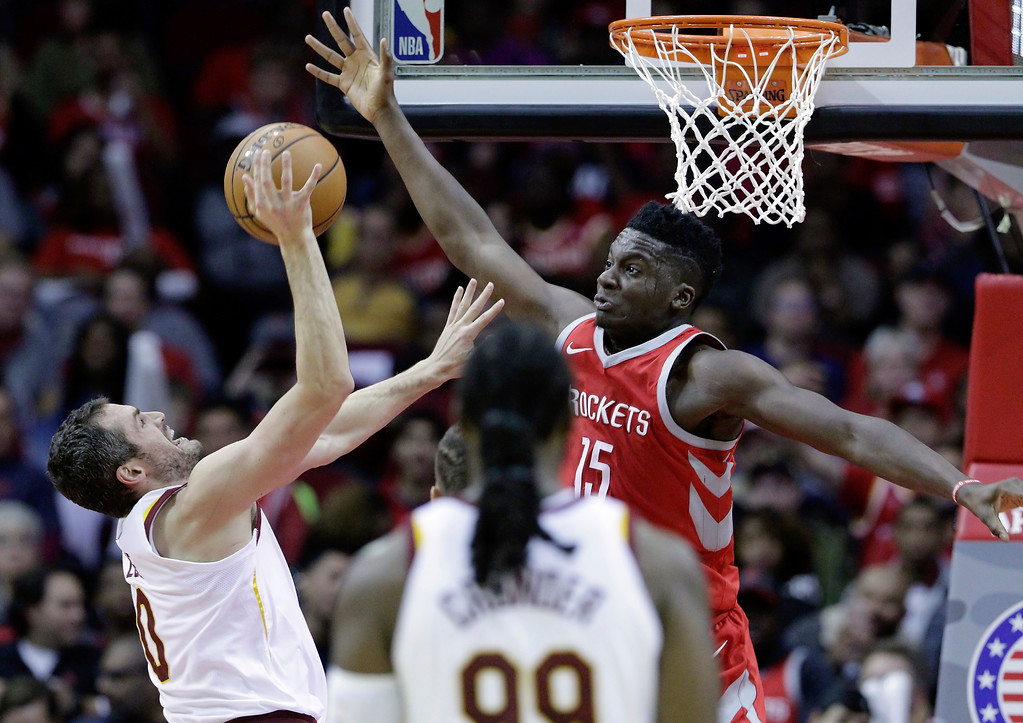 . Cleveland Cavaliers forward Kevin Love (0) shoots, but has the ball knocked away by Houston Rockets center Clint Capela (15) during the second half of an NBA basketball game Thursday, Nov. 9, 2017, in Houston. (AP Photo/Michael Wyke)