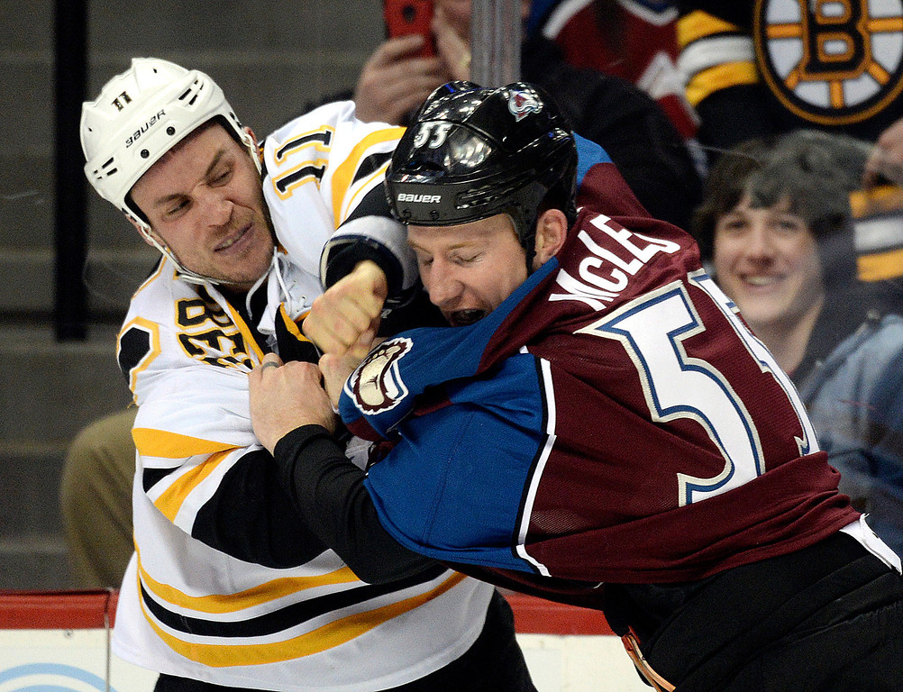 . Boston center Gregory Campbell, left, tussled with Colorado wing Cody McLeod, right, in the first period. The Colorado Avalanche hosted the Boston Bruins at the Pepsi Center Friday night, March 21, 2014. (Photo by Karl Gehring/The Denver Post)