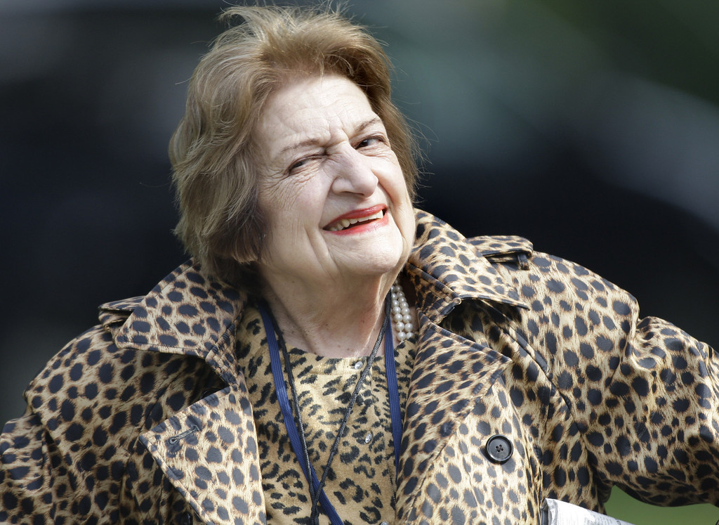 . In this Oct. 16, 2007 file photo, veteran White House correspondent Helen Thomas smiles as she leaves the White House after attending a briefing. Thomas, the White House correspondent who used her seat in the front row of history to grill nine presidents, died July 20, 2013. She was 92. (AP Photo/Ron Edmonds, File)