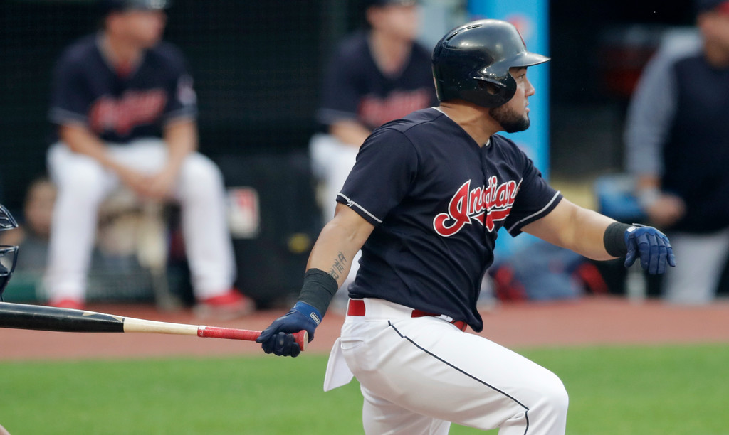 . Cleveland Indians\' Melky Cabrera follows through on his RBI single off Minnesota Twins starting pitcher Kohl Stewart during the first inning of a baseball game Wednesday, Aug. 29, 2018, in Cleveland. (AP Photo/Tony Dejak)