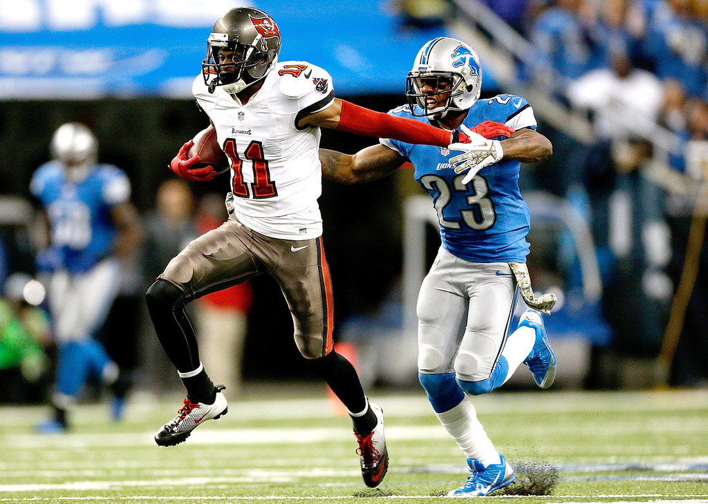 . Tiquan Underwood #11 of the Tampa Bay Buccaneers catches a touchdown pass in front of Chris Houston #23 of the Detroit Lions in the fourth quarter at Ford Field on November 24, 2013 in Detroit, Michigan. (Photo by Gregory Shamus/Getty Images)
