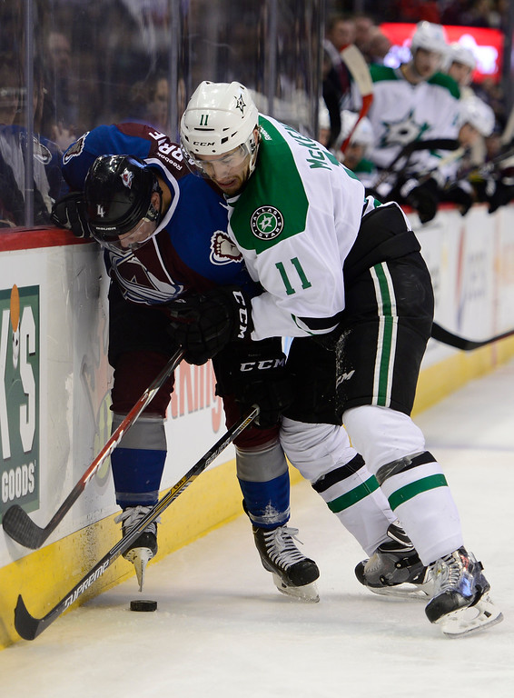 . Colorado Avalanche defenseman Tyson Barrie (4) battles over the puck with Dallas Stars left wing Curtis McKenzie (11) during the third period Saturday, February 14, 2015 at the Pepsi Center in Denver, Colorado. (Photo By Brent Lewis/The Denver Post)