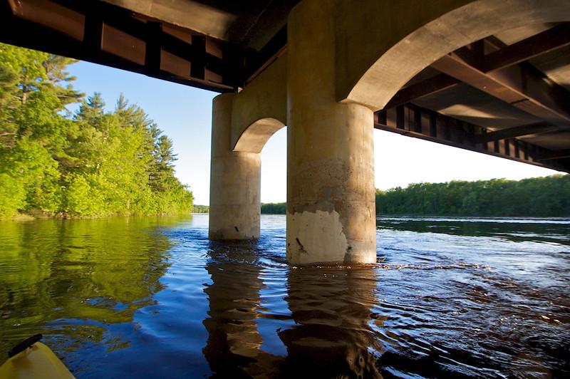 Under the highway 70 bridge.
