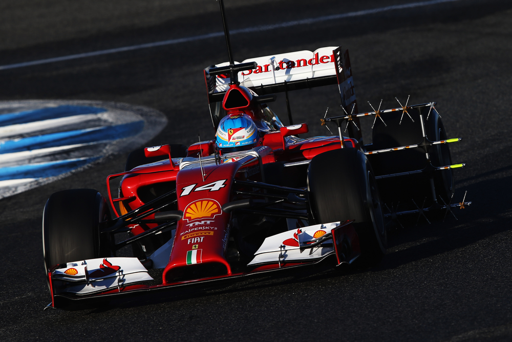 . Fernando Alonso of Spain and Ferrari runs with sensors on the new F14T during day three of Formula One Winter Testing at the Circuito de Jerez on January 30, 2014 in Jerez de la Frontera, Spain.  (Photo by Mark Thompson/Getty Images)