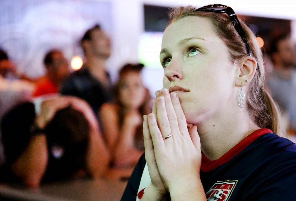 . Erica Skog, 30, of Redlands, watches the final minutes of the USA vs Belgium world cup game at a viewing party on Tuesday, July 1, 2014 at Darby\'s American Cantina in Redlands, Ca. (Photo by Micah Escamilla/The Sun)