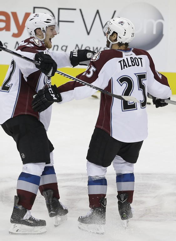 . Colorado Avalanche center Maxime Talbot (25) celebrates scoring a shootout goal with teammate Gabriel Landeskog (92) during overtime in an NHL hockey game against the Dallas Stars on Tuesday, Feb. 3, 2015, in Dallas. The Avalanche won 3-2. (AP Photo/LM Otero)