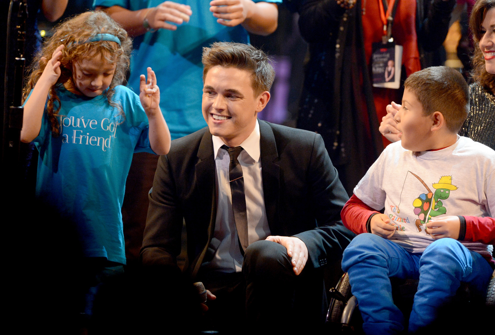Description of . Singer Jesse McCartney performs onstage during a celebration of Carole King and her music to benefit Paul Newman's The Painted Turtle Camp at the Dolby Theatre on December 4, 2012 in Hollywood, California.  (Photo by Michael Buckner/Getty Images for The Painted Turtle Camp)