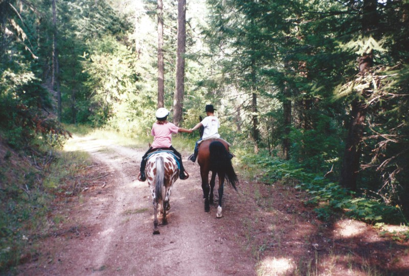 Devon and Eric riding horses.jpeg