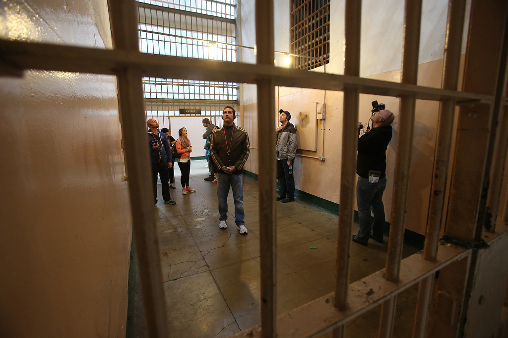 . Visitors tour the main cellhouse on Alcatraz Island on Monday, March 18, 2013 in San Francisco, Calif. The federal prison on the island closed 50 years ago and is now a tourist destination.  (Aric Crabb/Staff)