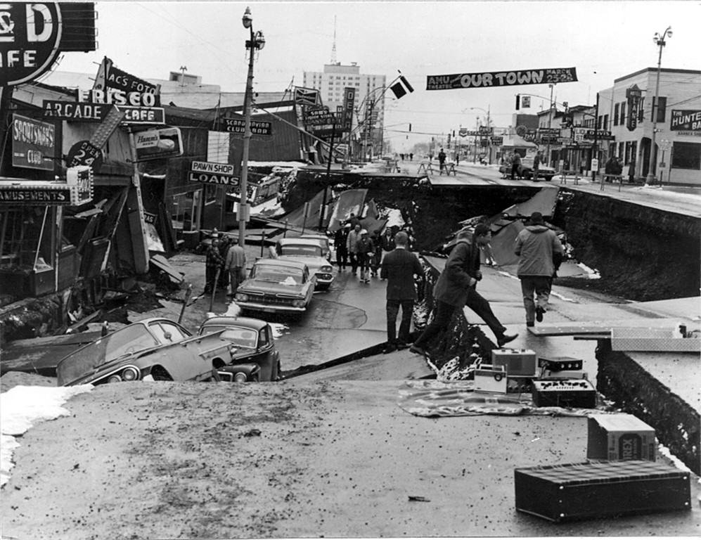 . Alaska Earthquake March 27, 1964. Collapse of Fourth Avenue near C Street in Anchorage due to a landslide caused by the earthquake. Before the shock, the sidewalk on the left, which is in the graben, was at street level on the right. The graben subsided 11 feet in response to 14 feet of horizontal movement. Photo by U.S. Army, 1964.  U.S. Geological Survey photo
