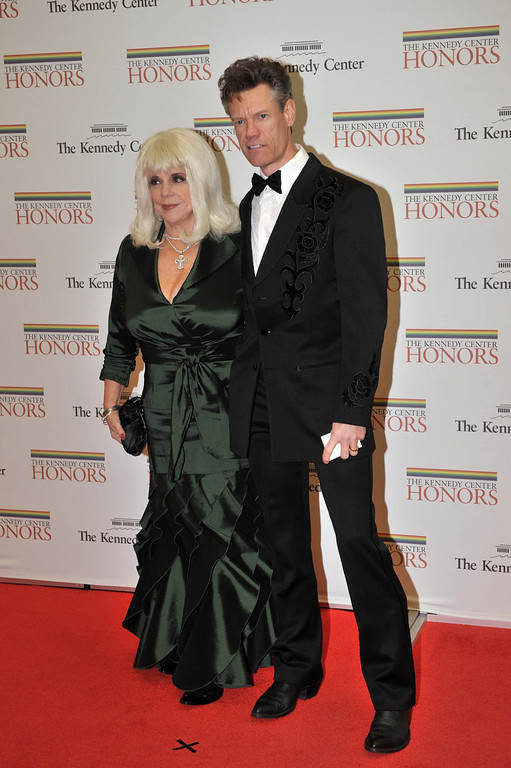 . Musician Randy Travis and his wife arrive for the State Department Dinner for the Kennedy Center Honors gala Saturday, Dec. 6, 2008 at the State Department in Washington.   (AP Photo/Kevin Wolf)