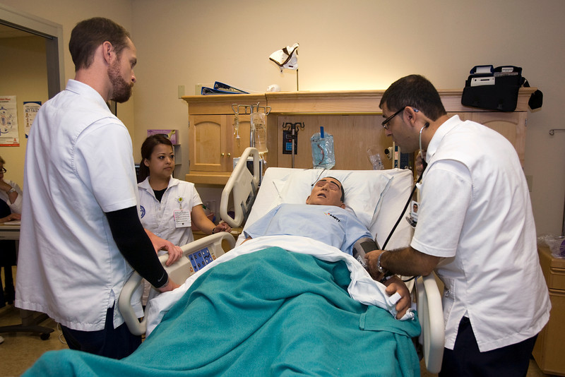 Sacramento City College Extended Campus nursing students (from L) Justin Seither, Maiyen Tran and Hayat Niazi participate in a CVA simulation exercise in the SCC/EX sim lab.