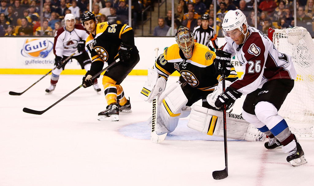 . Paul Stastny #26 of the Colorado Avalanche carries the puck in front of goalie Tuukka Rask #40 of the Boston Bruins in the second period during the game on October 10, 2013 at TD Garden in Boston, Massachusetts. (Photo by Jared Wickerham/Getty Images)