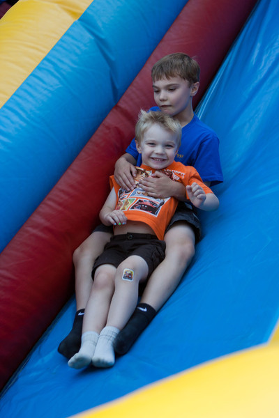 Enjoying the inflatable slide at the Boy Scouts Picnic