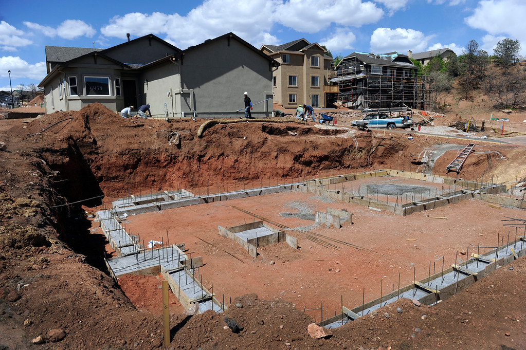 . Homes are springing up in the Parkside subdivision-some are finished and nearly finished while others are just starting with a foundation. (Photo By Kathryn Scott Osler/The Denver Post)