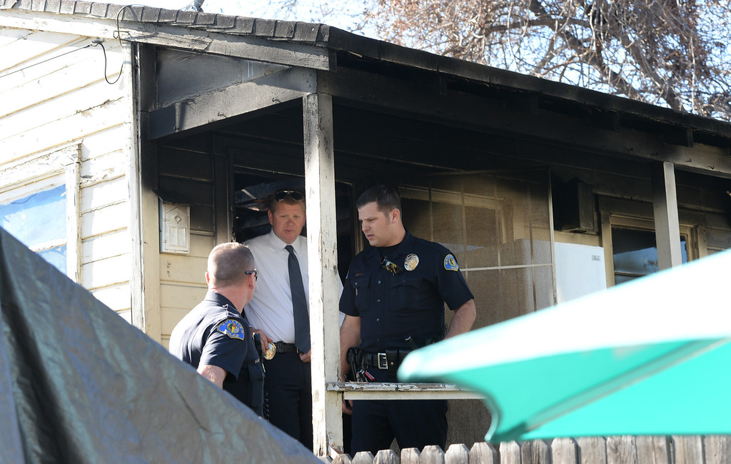 . Whittier Police officers and lead Detective Chad Hoeppner, center, investigate a house fire on the 13500-block of Via Del Palma in Whittier Where two residents were found dead inside on Thursday January 2, 2014. (Staff Photo by Keith Durflinger/Whittier Daily News)