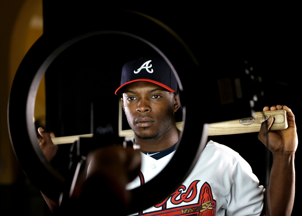 . Atlanta Braves outfielder Justin Upton poses for a photographer during a spring training baseball picture day Wednesday, Feb. 20, 2013, in Kissimmee, Fla. (AP Photo/David J. Phillip)
