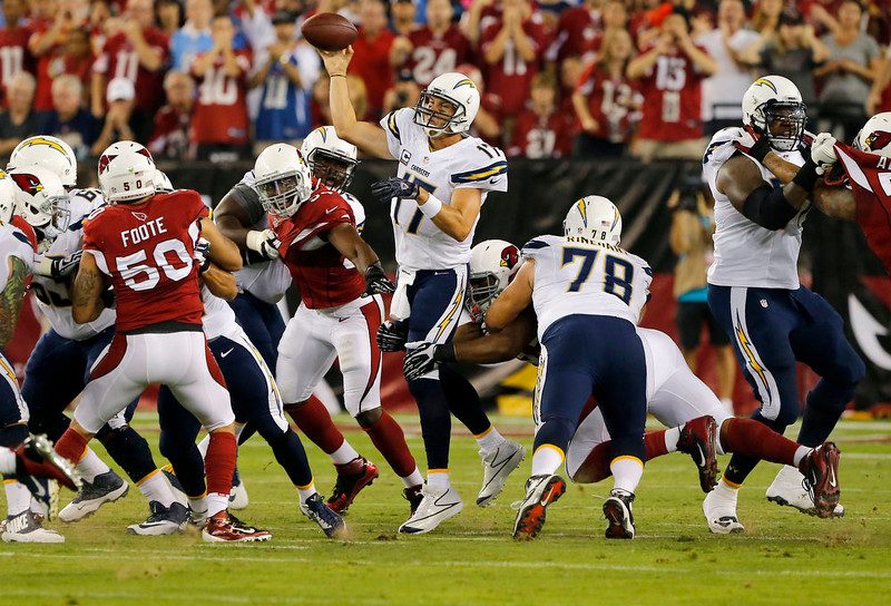 . San Diego Chargers quarterback Philip Rivers (17) throws against the Arizona Cardinals during the first half of an NFL football game, Monday, Sept. 8, 2014, in Glendale, Ariz. (AP Photo/Rick Scuteri)