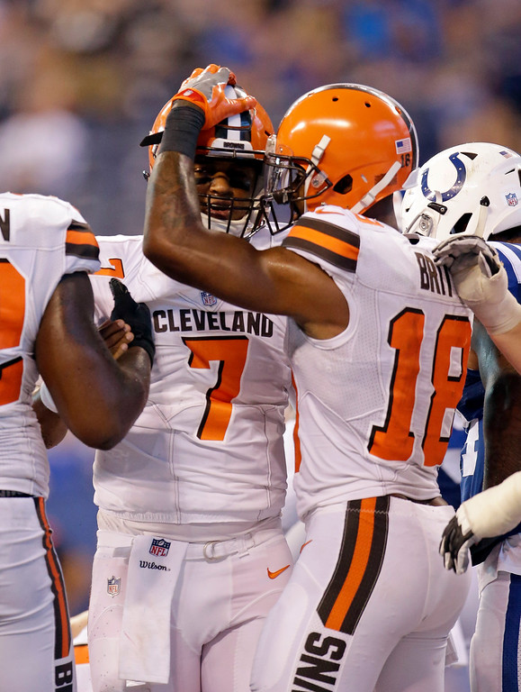 . Cleveland Browns quarterback DeShone Kizer (7) celebrates a touchdown with wide receiver Kenny Britt (18) during the second half of an NFL football game against the Indianapolis Colts in Indianapolis, Sunday, Sept. 24, 2017. (AP Photo/AJ Mast)