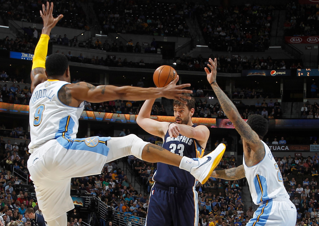 . Memphis Grizzlies center Marc Gasol, center, of Spain, looks to pass the ball under pressure from Denver Nuggets guard Andre Iguodala, front left, and forward Wilson Chandler in the first quarter of an NBA basketball game in Denver, Friday, March 15, 2013. (AP Photo/David Zalubowski)
