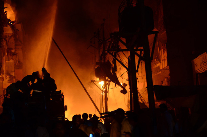 . Pakistani rescuers gather at the site of the bomb blast in Karachi on March 3, 2013.  A bomb attack in Pakistan\'s largest city Karachi on Sunday killed at least 23 people, including women and children, and wounded 50 others, police said.  ASIF HASSAN/AFP/Getty Images