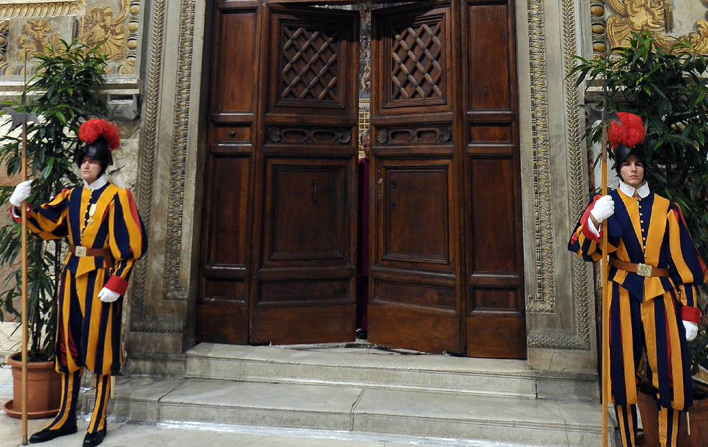 ". This handout picture released by the Vatican Press Office on March 12, 2013 shows the doors of the Sistine chapel being closed at the start of a papal election election.  �AFP PHOTO/OSSERVATORE ROMANO""-/AFP/Getty Images"