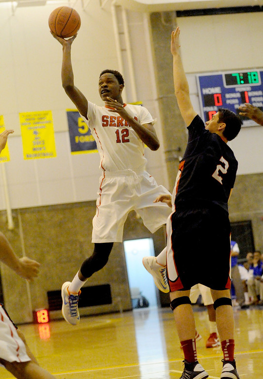 . 03-12-2013--(LANG Staff Photo by Sean Hiller)-Serra\'s Tavrion Dawson (12) fires off a shot overPacific Hills\' Adam Plax (2) in Tuesday\'s boys basketball IV Southern California Regional semifinal at L.A. Southwest College.