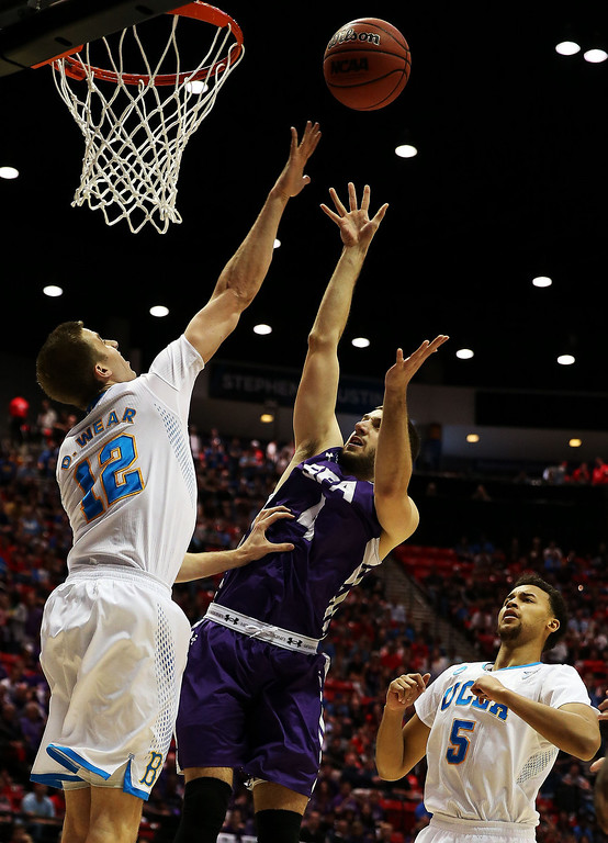 . Nikola Gajic #4 of the Stephen F. Austin Lumberjacks goes up against David Wear #12 of the UCLA Bruins in the first half during the third round of the 2014 NCAA Men\'s Basketball Tournament at Viejas Arena on March 23, 2014 in San Diego, California.  (Photo by Jeff Gross/Getty Images)