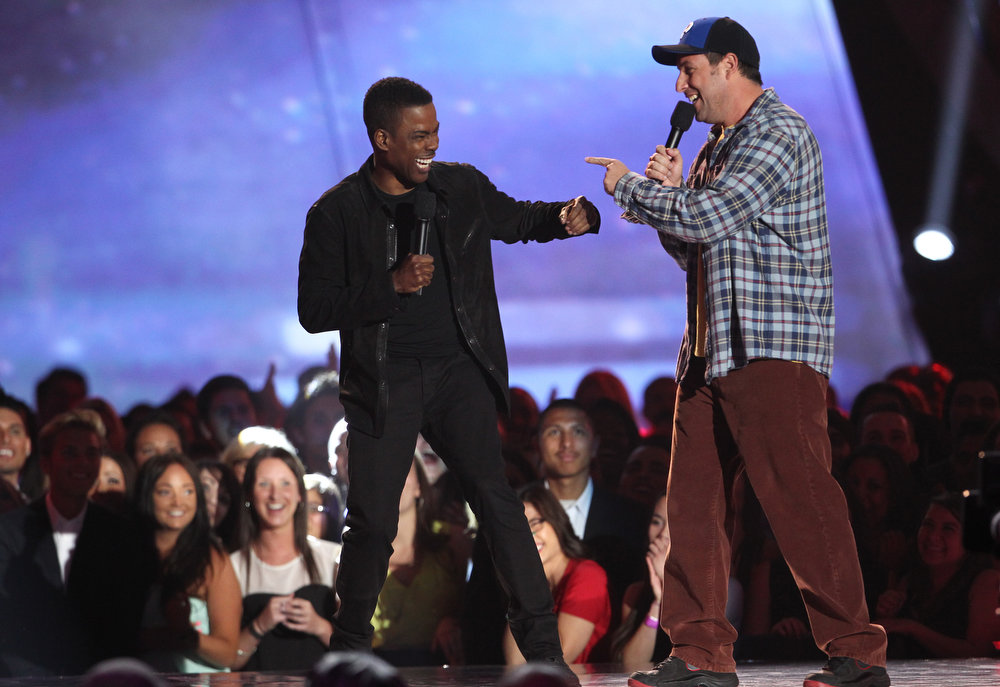 . Actors Adam Sandler, right, and Chris Rock present the award for best WTF moment at the MTV Movie Awards in Sony Pictures Studio Lot in Culver City, Calif., on Sunday April 14, 2013. (Photo by Matt Sayles/Invision /AP)