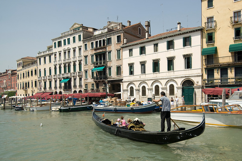 Gondola taking tourists through Grand Canal in Venice, Italy