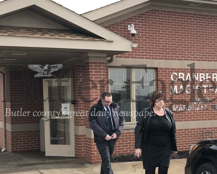 Photo by J.W. Johnson Jr.Matthew Leonard leaves district court in Cranberry Township following a hearing Friday.