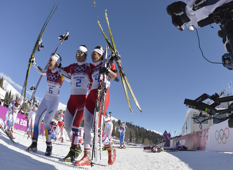 . Sweden\'s Charlotte Kalla, Norway\'s Marit Bjoergen and Norway\'s Heidi Weng  celebrate after the Women\'s Cross-Country Skiing 7,5km + 7,5km Skiathlon at the Laura Cross-Country Ski and Biathlon Center during the Sochi Winter Olympics on February 8, 2014 in Rosa Khutor.    (ODD ANDERSEN/AFP/Getty Images)