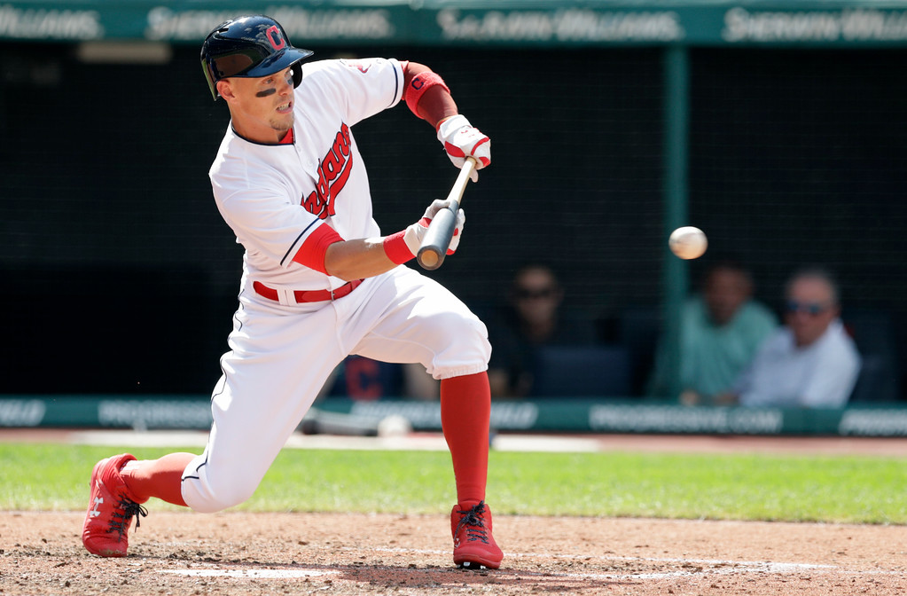 . Cleveland Indians\' Brandon Guyer bunts in the eighth inning of a baseball game against the Kansas City Royals, Wednesday, Sept. 5, 2018, in Cleveland. (AP Photo/Tony Dejak)