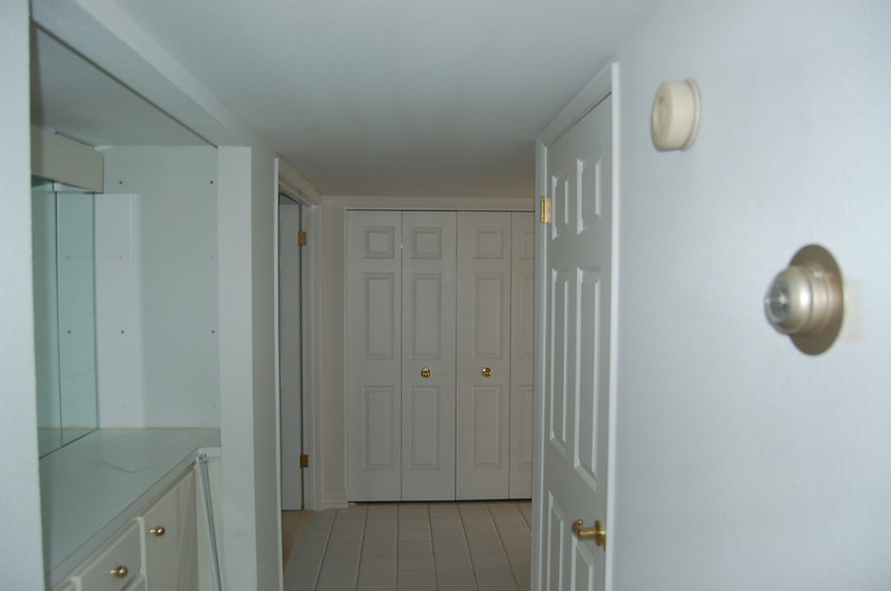 Looking back toward the bedrooms (master on the left; guest bedroom on the right), with the dry bar on the left.