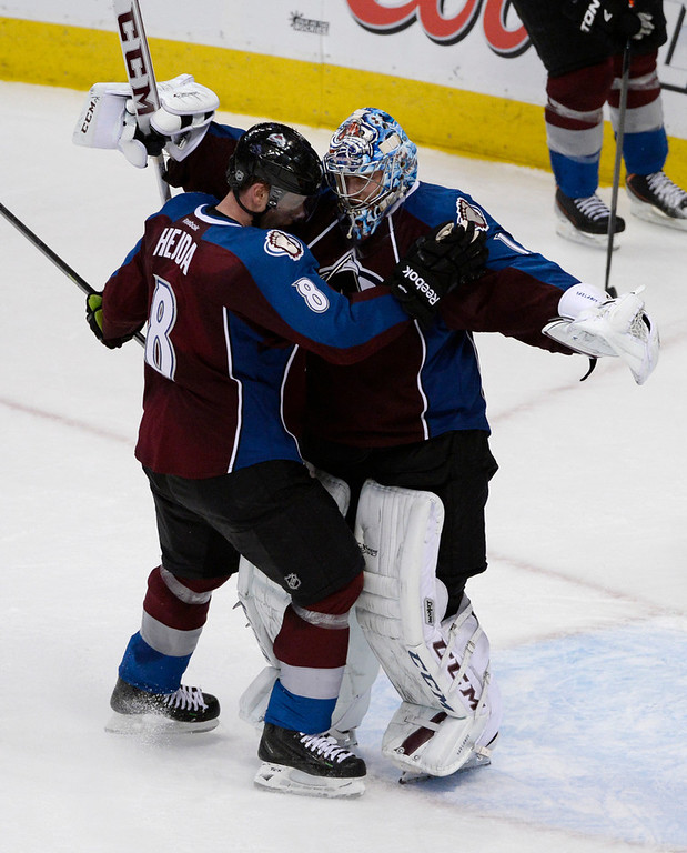 . Colorado Avalanche goalie, Semyon Varlamov, right, celebrates his teams victory over the San Jose Sharks with teammate, Jan Hejda, at the Pepsi Center Saturday afternoon, March 29, 2014. The Av\'s won 3-2 securing a playoff spot with the win. (Photo By Andy Cross / The Denver Post)