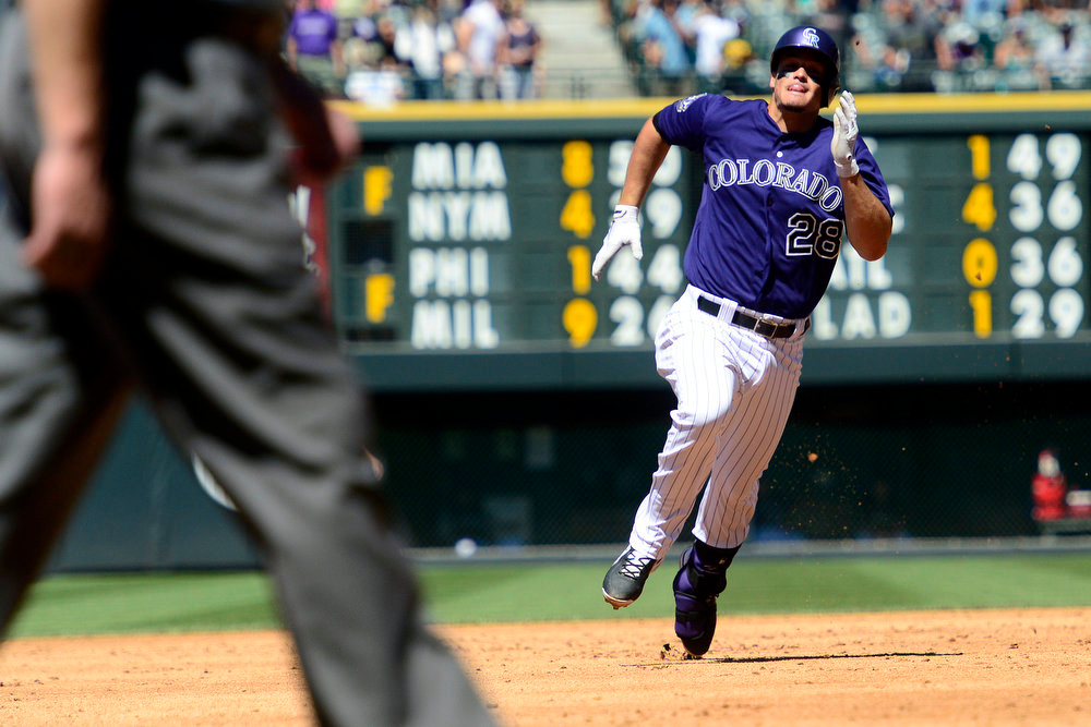 . Colorado Rockies third baseman Nolan Arenado (28) legs out a triple during the fourth inning in Denver. The Colorado Rockies hosted the San Diego Padres at Coors Field on Sunday, June 9, 2013. (Photo by AAron Ontiveroz/The Denver Post)