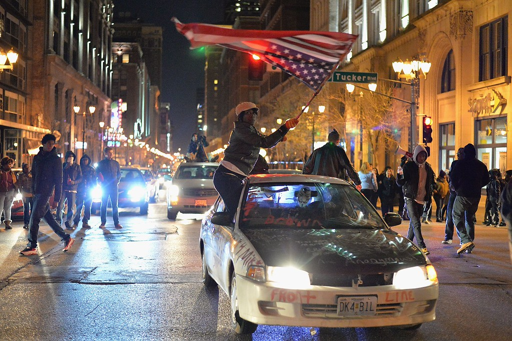 . Demonstrators march in protest on the streets of St. Louis, Missouri on December 3, 2014.  Nationwide outrage and protests have erupted since a New York City grand jury also decided not to indict a white police officer in the death of Eric Garner in Staten Island, New York on July 17, 2014 . AFP PHOTO/Michael B. Thomas/AFP/Getty Images