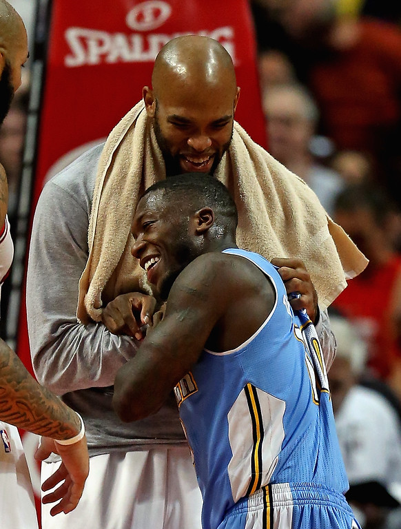 . Taj Gibson #22 of the Chicago Bulls and Nate Robinson #10 of the Denver Nuggets share a laugh and a hug after a preseason game at the United Center on October 25, 2013 in Chicago, Illinois. The Bulls defeated the Nuggets 94-89.  (Photo by Jonathan Daniel/Getty Images)