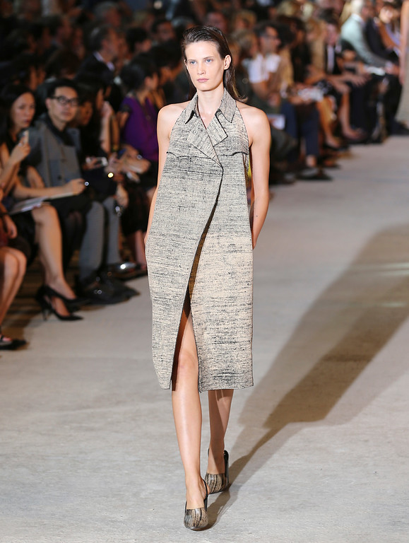 . A model wears a creation for Costume National women\'s Spring-Summer 2014 collection, part of the Milan Fashion Week, unveiled in Milan, Italy, Thursday, Sept. 19, 2013. (AP Photo/Antonio Calanni)