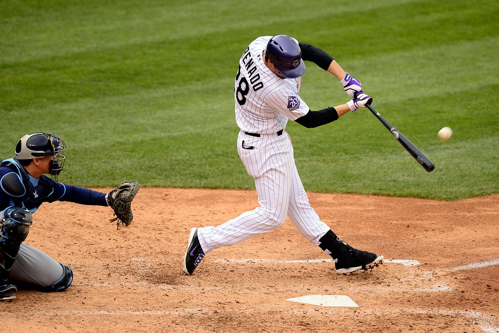 . DENVER, CO - MAY 5: Nolan Arenado (28) of the Colorado Rockies hits a solo home run against the Tampa Bay Rays during the Rockies\' 8-3 loss.   (Photo by AAron Ontiveroz/The Denver Post)