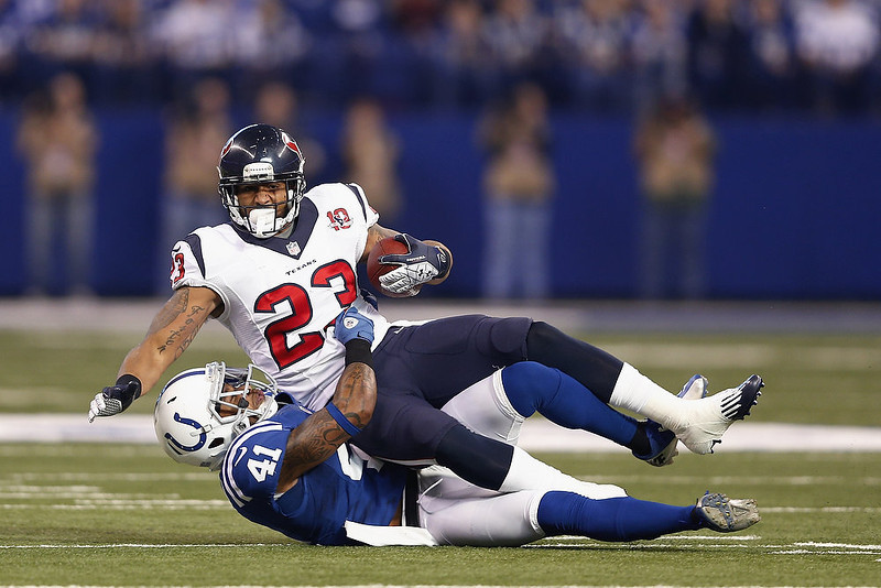 . Antoine Bethea #41 of the Indianapolis Colts tackles Arian Foster #23 of the Houston Texans during the game at Lucas Oil Stadium on December 30, 2012 in Indianapolis, Indiana. (Photo by Joe Robbins/Getty Images)