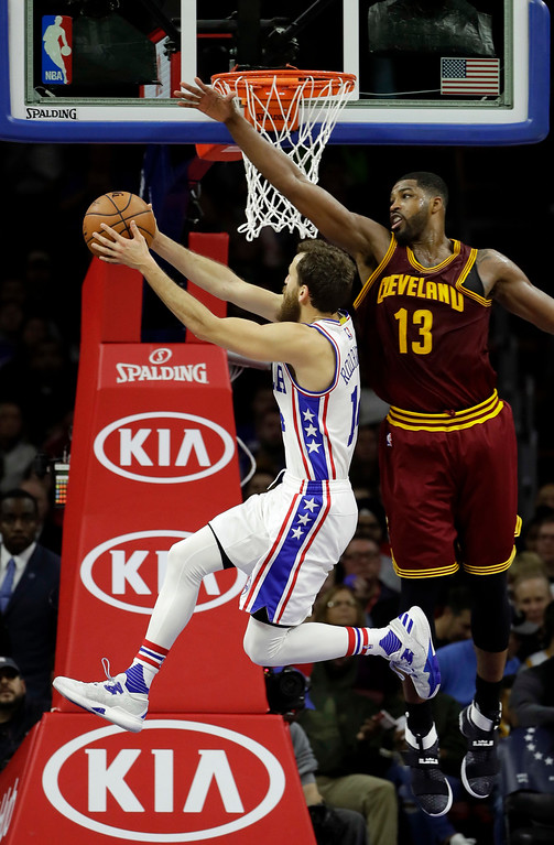 . Philadelphia 76ers\' Sergio Rodriguez, left, goes up for a shot against Cleveland Cavaliers\' Tristan Thompson during the first half of an NBA basketball game, Sunday, Nov. 27, 2016, in Philadelphia. (AP Photo/Matt Slocum)