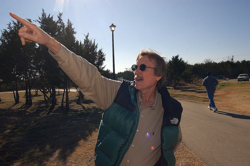 . Dr. Mark Wilson of Harker Heights, Texas, points to the spot in the sky where he watched the space shuttle Columbia fall after an explosion destroyed the craft, killing all seven astronauts,   Saturday, Feb. 1, 2003. Dr. Wilson said he thought he saw a comet, but was told by his wife that it was the shuttle. (AP Photo/Killeen Daily Herald, Steve Traynor)