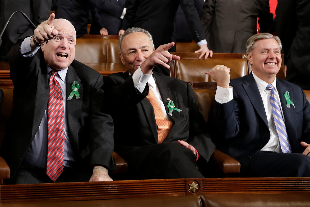 Description of . From left, Sen. John McCain, R-Ariz., Sen. Charles Schumer, D-N.Y. and Sen. Lindsey Graham, R-S.C. sit on Capitol Hill in Washington, Tuesday, Feb. 12, 2013, before President Barack Obama's State of the Union address during a joint session of Congress. (AP Photo/Charles Dharapak, Pool)