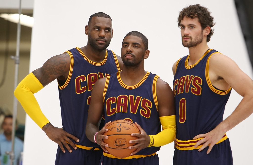 . Cleveland Cavaliers\' Lebron James, left, Kyrie Irving, center, and Kevin Love pose for a portrait during the NBA team\'s media day, Monday, Sept. 28, 2015, in Independence, Ohio. (AP Photo/Ron Schwane)