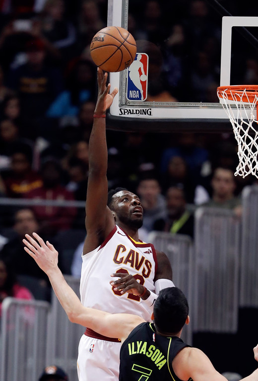 . Cleveland Cavaliers forward Jeff Green (32) shoots against Atlanta Hawks forward Ersan Ilyasova (7) during the first half of an NBA basketball game Friday, Feb. 9, 2018, in Atlanta. (AP Photo/John Bazemore)