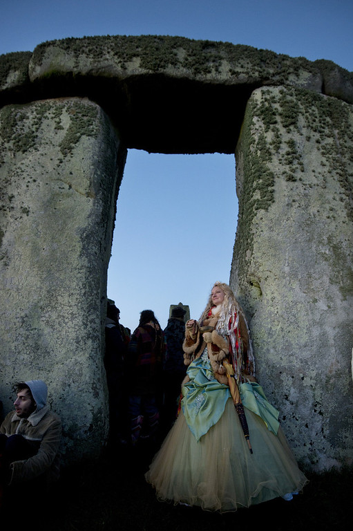 . Revellers celebrate the pagan festival of \'Winter Solstice\' at Stonehenge in Wiltshire in southern England on December 21, 2012. BEN STANSALL/AFP/Getty Images