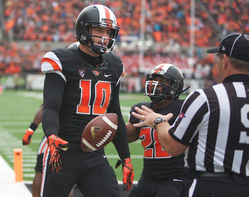 . Oregon State Beavers tight end Caleb Smith (10) hands off the ball after scoring in the 1st-half against the Colorado Buffaloes at Reser Stadium in Corvallis Saturday.  Photo by Randy L. Rasmussen/The Oregonian