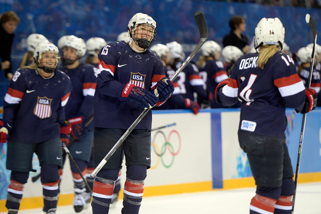 . Anne Schleper (15) of the U.S.A. and Brianna Decker (14) celebrate a goal by Amanda Kessel (28) against Switzerland during the first period of action at the Shayba Arena. Sochi 2014 Winter Olympics on Monday, February 10, 2014. (Photo by AAron Ontiveroz/The Denver Post)