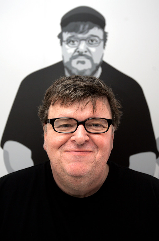 ". American director Michael Moore poses for a portrait at the 60th International film festival in Cannes, southern France, on Monday, May 21, 2007. Michael Moore\'s new film ""Sicko,\"" premiered at the festival on Saturday, May 19, 2007. (AP Photo/Kirsty Wigglesworth)"